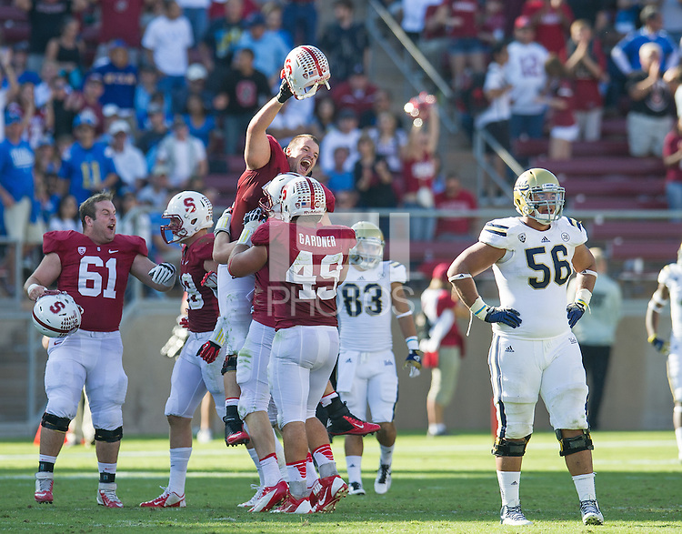 STANFORD, CA - October 19, 2013:  Stanford Cardinal Conor McFadden (61) and Kevin Danser (76) celebrate their win over UCLA after the Stanford Cardinal vs the UCLA Bruins at Stanford Stadium in Stanford, CA. Final score Stanford Cardinal 24, UCLA Bruins  10.