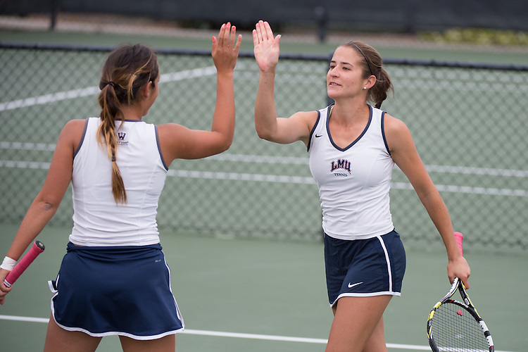 April 22, 2015; San Diego, CA, USA; Loyola Marymount Lions tennis players Lisa Piller (right) and Ellie Grossman (left) during the WCC Tennis Championships at Barnes Tennis Center.