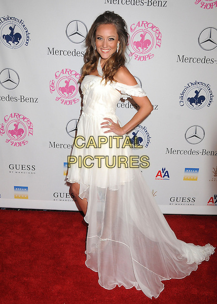 Lauren C. Mayhew.26th Annual Carousel of Hope Gala held at the Beverly Hilton Hotel, Beverly Hills, California, USA, 20th October 2012..full length white off the shoulder dress hand on hip train tulle sheer .CAP/ADM/BP.©Byron Purvis/AdMedia/Capital Pictures.