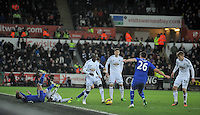 SWANSEA, WALES - JANUARY 17:   of  during the Barclays Premier League match between Swansea City and Chelsea at Liberty Stadium on January 17, 2015 in Swansea, Wales. Modou Barrow on the ball.