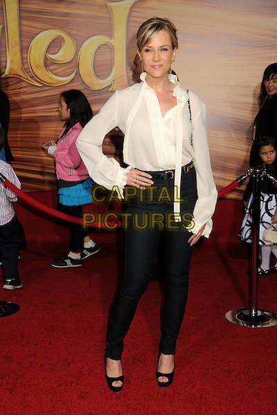 """JULIE BENZ.""""Tangled"""" Los Angeles Premiere held at the El Capitan Theatre, Hollywood, California, USA..November 14th, 2010.full length top jacket jeans blouse shirt white hand on hip .CAP/ADM/BP.©Byron Purvis/AdMedia/Capital Pictures."""