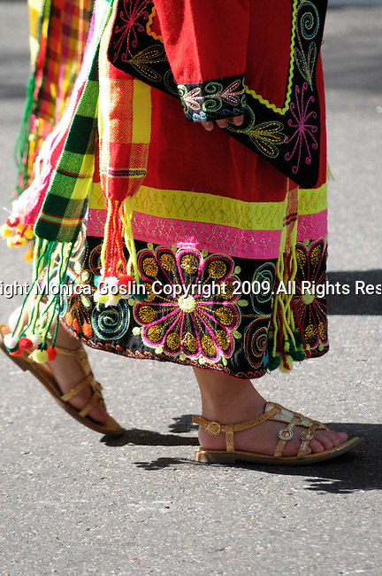 The Hispanic Parade in New York City. A woman wearing traditional clothes and representing Bolivia in the Hispanic Parade in New York City. Detail of woman's shoes in the Hispanic Parade in New York City.