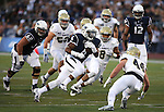 Nevada's Don Jackson (6) runs up the middle against UC Davis during the first half of an NCAA college football game in Reno, Nev. on Thursday, Sept. 3, 2015. (AP/Cathleen Allison)
