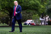 United States President Donald Trump crosses the South Lawn after arriving at the White House on May 5, 2018 in Washington, DC. President Trump traveled to Cleveland, Ohio to speak at Public Hall ahead of state primary elections.  <br /> Credit: Zach Gibson / Pool via CNP /MediaPunch