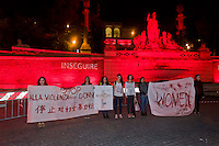 Roma 25 Novembre 2014<br /> Piazza del Popolo  si tinge di rosso nella Giornata internazionale contro la violenza sulle donne a Roma.<br /> Rome, Italy. 25th November 2014 -- Piazza of Popolo in Rome is lit up in red light in observance of the International Day to stop violence against women.