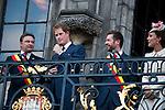 Le Prince William, Kate, la Duchesse de Cambridge, le Prince Harry et le Premier ministre belge Elio Di Rupo saluent le public depuis le balcon de l'H&ocirc;tel de ville de Mons, a` l&rsquo;occasion du Centie`me anniversaire de la<br />  Premie`re Guerre mondiale.<br /> <br /> <br />  Belgique, Mons, . 4 Ao&ucirc;t 2014.<br /> <br />  Prince William, Kate, Duchess of Cambridge, Prince Harry and Belgian Prime Minister Elio Di Rupo pictured during a reception in Mons city hall, ahead of a commemoration at Saint-Symphorien cemetery, part of the 100th anniversary of the Commemoration of the 100th anniversary of the First World War.<br /> <br />  Belgium, Mons, August 4, 2014.