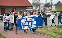NWA Democrat-Gazette/BEN GOFF @NWABENGOFF<br /> Participants gather next to South Thompson Street Saturday, March 24, 2018, during for a March for our Lives event in downtown Springdale. The local march was organized by students from Springdale Har-Ber High in solidarity with marches across the country today to call for an end to gun violence.