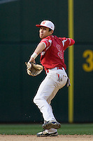 April 24, 2010: Newport High School shortstop Trace Tam Sing fires a throw across the diamond during a game against Highline High School at Safeco Field in Seattle, Washington.