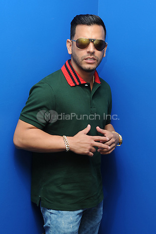 FORT LAUDERDALE, FL - MAY 12: Tito El Bambino poses for a portrait at Radio Station MEGA 94.9 on May 12, 2016 in Fort Lauderdale, Florida. Credit: mpi04/MediaPunch