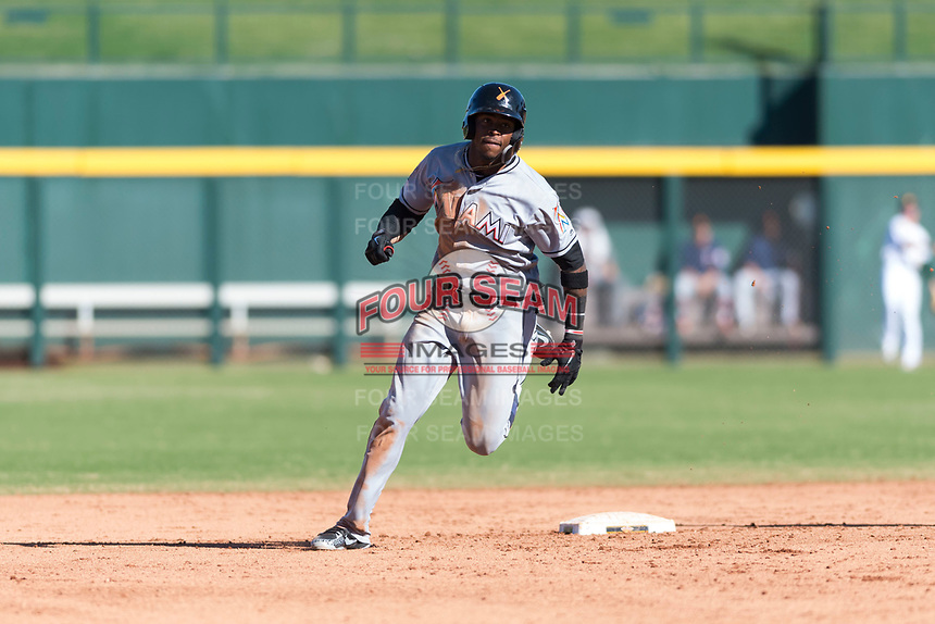 Salt River Rafters right fielder Monte Harrison (4), of the Miami Marlins organization, rounds second base during an Arizona Fall League game against the Mesa Solar Sox at Sloan Park on October 30, 2018 in Mesa, Arizona. Salt River defeated Mesa 14-4 . (Zachary Lucy/Four Seam Images)