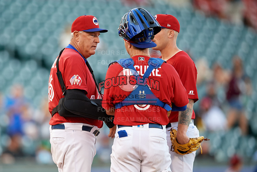 Buffalo Bisons pitching coach Bob Stanley (46) talks with catcher Reese McGuire (3) and starting pitcher Sean Reid-Foley (38) during a game against the Syracuse Chiefs on July 6, 2018 at Coca-Cola Field in Buffalo, New York.  Buffalo defeated Syracuse 6-4.  (Mike Janes/Four Seam Images)
