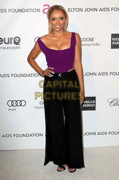 Kat Graham.21st Annual Elton John Academy Awards Viewing Party held at West Hollywood Park, West Hollywood, California, USA..February 24th, 2013.oscars full length hands on hips Katerina black skirt slit split purple sleeveless top cleavage .CAP/ADM/KB.©Kevan Brooks/AdMedia/Capital Pictures.