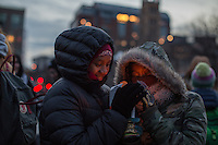 NEW YORK,NY December 16,2016: Two young women warm their hands with a candle during a vigil to protest against the Syrian government and the killing of innocent people in Washington Square Park, in New York City, December  16,2016. Photo by VIEWpress/Maite H. Mateo