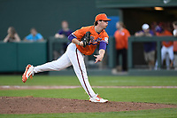 Relief pitcher Ryne Huggins (37) of the Clemson Tigers delivers a pitch in a game against the William and Mary Tribe on February 16, 2018, at Doug Kingsmore Stadium in Clemson, South Carolina. Clemson won, 5-4 in 10 innings. (Tom Priddy/Four Seam Images)