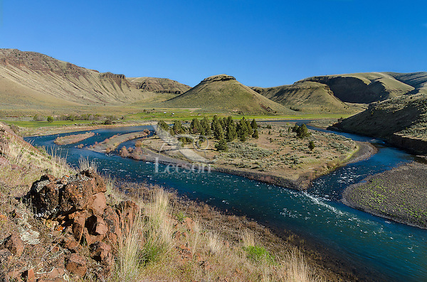 John Day River near confluence with 30 Mile Creek (Creek comes in from the left and joins river in about the middle of the photo).  Buildings part of Rattray River Ranch now land conserved by Western Rivers Conservancy.  Oregon.  April.