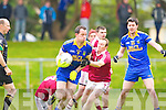 Spa Andrew Garnett is stopped by Dromid's Micheal O Siochain during their Intermediate semi final in Killorglin on Saturday