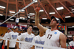 29 APR 2012:  Jimmy O'Leary (17) of Springfield College cuts down the net after defeating Carthage College during the Division III Men's Volleyball Championship held at Blake Arena in Springfield, MA.  Springfield defeated Carthage 3-0 to win the national title.  Jessica Rinaldi/NCAA Photos