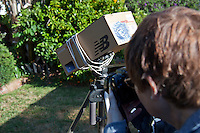 Sharon Worth of San Leandro, California, uses a homemade pinhole viewer made from a shoebox and tied to a tripod to photograph images of the May 20, 2012, solar eclipse from her backyard.