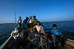 Fishermen from Shwe Thaung Yan leave to find their catch early in the morning. Usually, they fish at night, but with the full moon approaching the sea becomes rougher, and so they try their luck in the morning. They returned without any fish.
