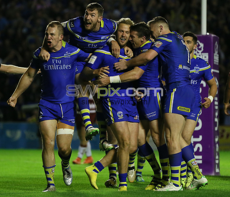 Picture by Paul Currie/SWpix.com - 16/09/2016 - Rugby League - First Utility Super League - Warrington Wolves v Wigan Warriors - Halliwell Jones Stadium, Warrington, England - Warrington Wolves' Joe Westerman celebrates scores the 4th try