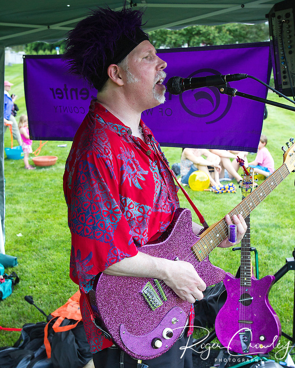 Christopher R and his Flying Purple Guitar performs at Kid's Zone on the State House lawn during July 3rd Celebration.