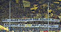 FUSSBALL  1. BUNDESLIGA  SAISON 2013/2014   3. SPIELTAG Borussia Dortmund - Werder Bremen                  23.08.2013 Dortmund Fans mit einem Banner mit der Aufschrift; DAS WAHRE GESICHT DER POLIZEI NRW SONNTAG BEIM UNS, MITTWOCH BEI GE