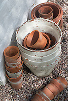 A collection of terracotta plant pots in the garden at Kirk House, Chipping, Preston, Lancashire.