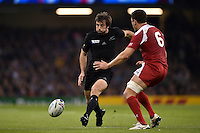 Conrad Smith of New Zealand puts in a grubber kick. Rugby World Cup Pool C match between New Zealand and Georgia on October 2, 2015 at the Millennium Stadium in Cardiff, Wales. Photo by: Patrick Khachfe / Onside Images