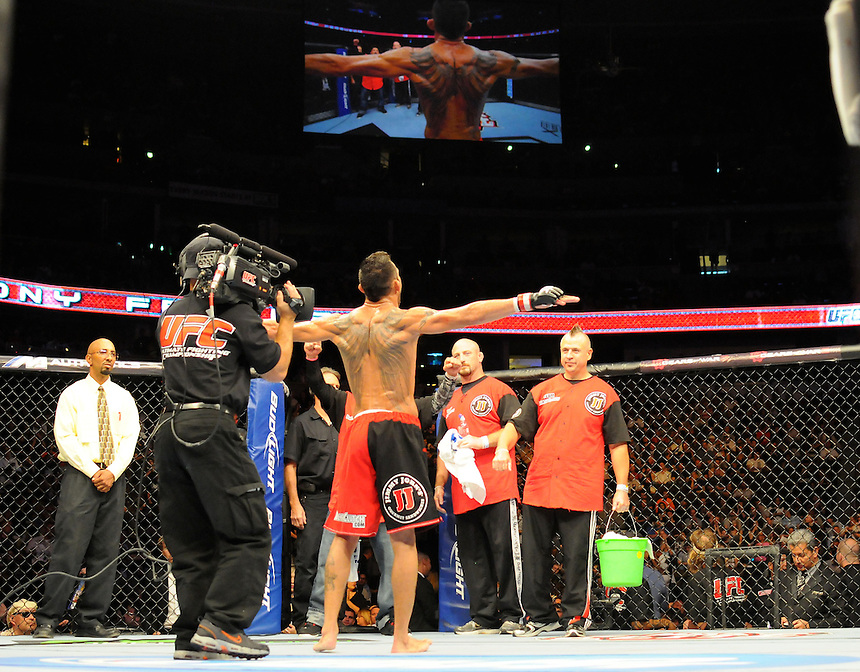 24 SEPTEMBER 2011:  Tony Ferguson shows his tattoo to the camera before a bout   during UFC 135 at the Pepsi Center in Denver, Colorado. *****For Editorial Use Only*****