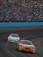 Apr 22, 2006; Phoenix, AZ, USA; Nascar Nextel Cup driver Clint Bowyer of the (07) Sylvania/Jack Daniels Chevrolet Monte Carlo leads Sterling Marlin during the Subway Fresh 500 at Phoenix International Raceway. Mandatory Credit: Mark J. Rebilas-US PRESSWIRE Copyright © 2006 Mark J. Rebilas..