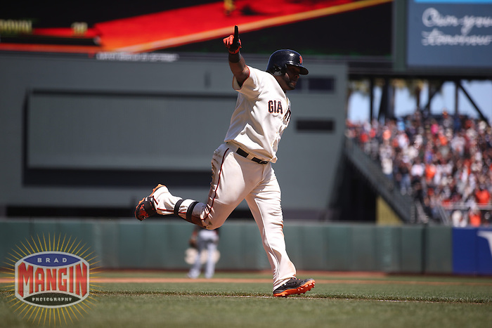 SAN FRANCISCO, CA - MAY 18:  Pablo Sandoval #48 of the San Francisco Giants runs the bases after hitting a home run against the Miami Marlins during the game at AT&T Park on Sunday, May 18, 2014 in San Francisco, California. Photo by Brad Mangin