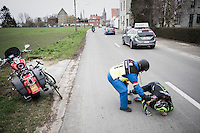 Ben Perry (CAN/Israel Cycling Academy) crashes in the back of the peloton & is helped by a road marchal <br /> <br /> 69th Kuurne-Brussel-Kuurne 2017 (1.HC)