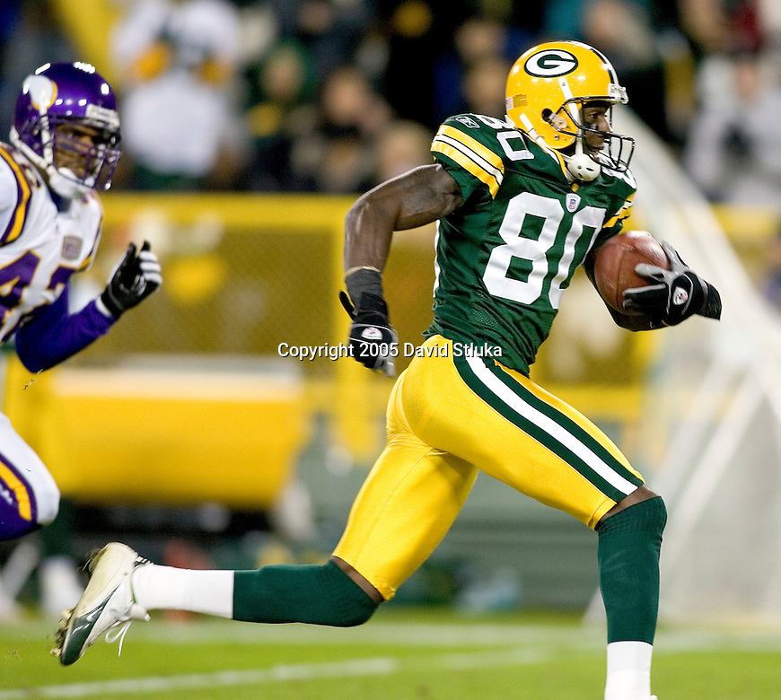 Wide receiver Donald Driver #80 of the Green Bay Packers scores on a 53 yard touchdown reception against the Minnesota Vikings at Lambeau Field on November 21, 2005 in Green Bay, Wisconsin. The Vikings defeated the Packers 20-17. (Photo by David Stluka)