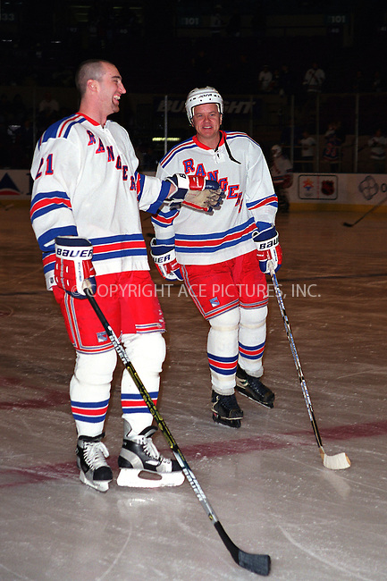 * WORLD SYNDICATION RIGHTS *  ..TIM ROBBINS and NY Ranger STEVE MCKENNA at the Fourth Annual Superskate 2002 Charity Hockey Event at Madison Square Garden in New York. January 19, 2002.  © 2002 by Alecsey Boldeskul.  ONE-TIME REPRODUCTION RIGHTS.