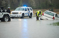 NWA Democrat-Gazette/BEN GOFF @NWABENGOFF<br /> An wrecker from Roadside Services Towing of Northwest Arkansas hooks up a vehicle Tuesday, March 27, 2018, that got stuck in a flooded ditch on South Champions Drive in Rogers.