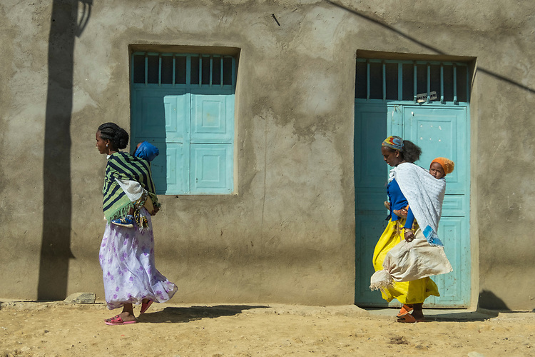 Mothers and babies compose this simplistic scene alongside the road in a Tigrai settlement.