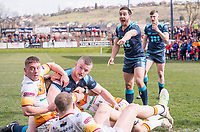 Picture by Allan McKenzie/SWpix.com - 25/03/2018 - Rugby League - Betfred Championship - Batley Bulldogs v Featherstone Rovers - Heritage Road, Batley, England - Featherstone's Tom Holmes protests as team mate Connor Farrell is held up short of the try line by Batley.