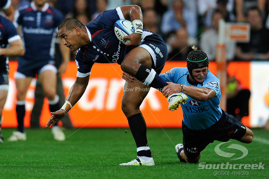 Cooper Vuna of the Rebels evades a tackle during the week one match of the 2011 Super 15 Rugby tournament between Melbourne Rebels and Waratahs at AAMI Park, Melbourne, Australia...This image is not for sale on this web site. Please contact Southcreek Global Media for licensing:.Toll Free: 1.800.934.5030.Canada: 701 Rossland Rd. East, Suite 315, Whitby, Ontario, Canada, L1N 9K3.USA: 10792 Baron Dr, Parma OH, USA 44130.Web: http://southcreekglobal.net/ and http://southcreekglobal.com/