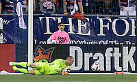 Foxborough, Massachusetts - July 9, 2016: In a Major League Soccer (MLS) match, the New England Revolution (blue/white) defeated Columbus Crew (yellow/white/blue), 3-1,at Gillette Stadium.<br /> Columbus Crew scores.