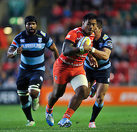 Manu Tuilagi takes on the Cardiff Blues defence. Pre-season friendly match, between Leicester Tigers and Cardiff Blues on August 29, 2014 at Welford Road in Leicester, England. Photo by: Patrick Khachfe / JMP