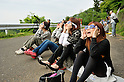 """May 21, 2012, Tokyo, Japan - People watch an annular solar eclipse in Kanagawa prefecture, Japan on May 21, 2012. An annular solar eclipse was observed over a wide area of Japan on Monday early morning. Millions of people watched as a rare """"ring of fire"""" eclipse crossed the skies. (Photo by Masahiro Tsurugi/AFLO) -ty-"""