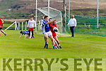 Alan O'Dwyer for Waterville under pressure to clear his lines for Templenoe's Brian Crowley.