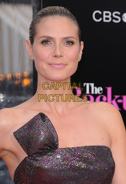 "HEIDI KLUM .at the CBS Films' L.A. Premiere of ""The Back-Up Plan"" held at The Village Theatre in Westwood, California, USA, April 21st, 2010..arrivals portrait headshot hair scarped up back make-up beauty strapless brown shimmery shiny sparkly bronze gold pink purple sequined sequin green khaki        .CAP/RKE/DVS.©DVS/RockinExposures/Capital Pictures."
