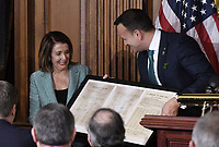 Leo Varadkar, Ireland's prime minister presents to Speaker of the United States House of Representatives Nancy Pelosi (Democrat of California) a copy of letter signed by 300 congressmen in 1937 to congratulate Ireland on its new constitution during the Friends of Ireland luncheon at the U.S. Capitol in Washington, D.C., U.S., on Thursday, March 14, 2019. <br /> Credit: Olivier Douliery / Pool via CNP/AdMedia