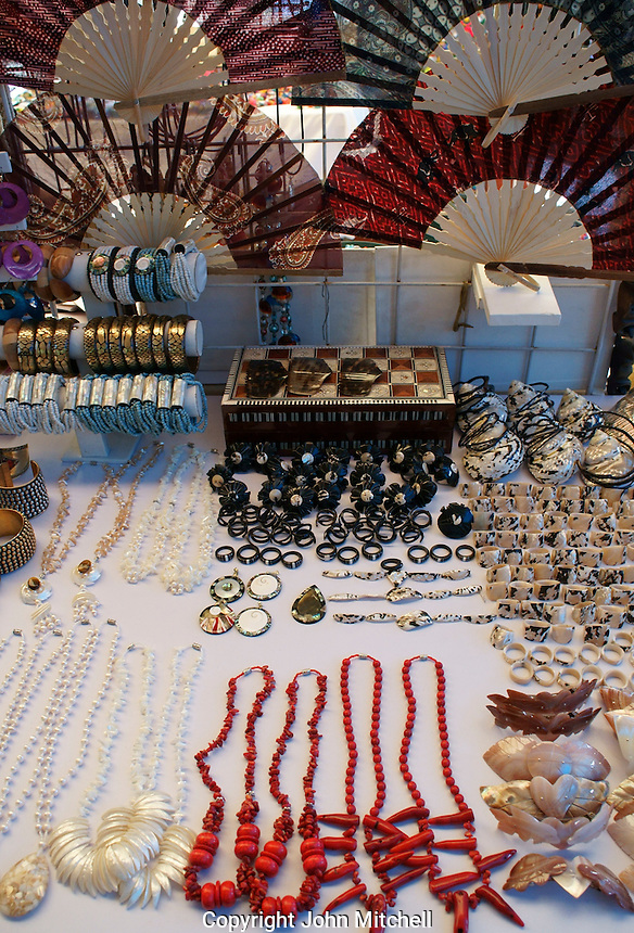 Sea shell jewelry and fans in  Mercado 28 souvenirs and handicrafts market in  Cancun, Mexico      .