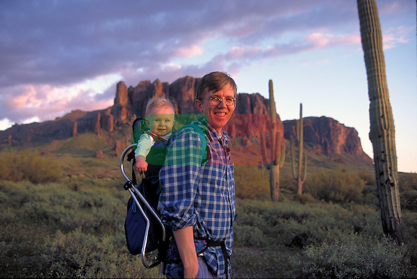 portrait of father and infant hiking in mountains
