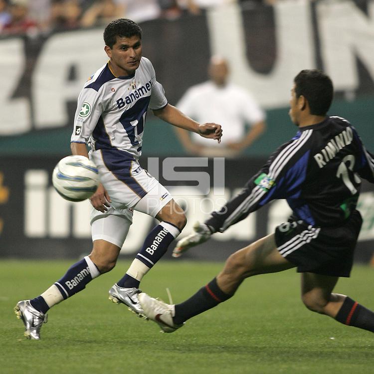 6 April 2005.  Pumas UNAM forward Joaquin Botero (9) crosses the ball past DC United goalkeeper Nick Rimando (18) during a CONCACAF Champion's Cup game at RFK Stadium in Washington, DC.