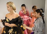 USWNT midfielder Leslie Osborne has her dress adjusted before a fashion show held by South Korean fashion designer Andre Kim.  The show featured women from seven of the eight teams participating in the Queen Peace Cup in Seoul, South Korea.