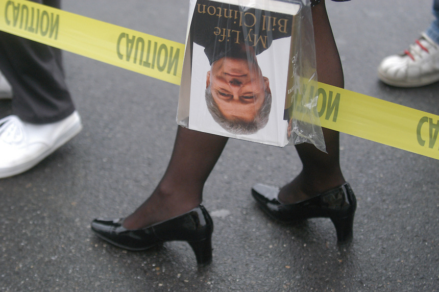 """A woman holds a copy of Bill Clinton's autobiography, """"My Life,"""" as she waits in line outside of the Manchester Barnes & Noble on April 28, 2005..(Concord Monitor photo/Danny Gawlowski)."""