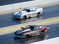 Apr. 13, 2012; Concord, NC, USA: NHRA pro mod driver Danny Rowe (near lane) races alongside Brad Brand during qualifying for the Four Wide Nationals at zMax Dragway. Mandatory Credit: Mark J. Rebilas-